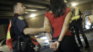 woman being arrested in cook county for driving under the influence of alcohol